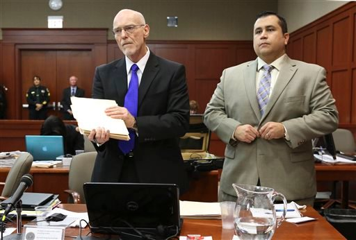 George Zimmerman, right, stands next to one of his defense attorneys, Don West, during his trial in Seminole circuit court, Friday, July 5, 2013, in Sanford, Fla. Zimmerman has been charged with second-degree murder for the 2012 shooting death of Trayvon.