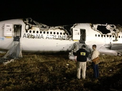 In this photo provided by the National Transportation Security Board (NTSB), NTSB investigators conduct a first site assessment overnight of the Asiana Airlines flight 214 that crashed at the San Francisco International Airport in San Francisco, Saturday,