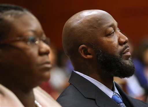 The parents of Trayvon Martin, Tracy Martin, right, and Sybrina Fulton, listen to the testimony of Sanford police officer Chris Serino during the George Zimmerman trial in Seminole Circuit Court, in Sanford, Fla., Monday, July 8, 2013. (AP)