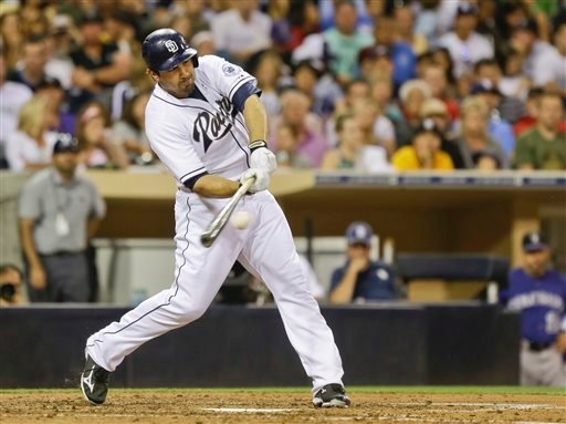 San Diego Padres' Carlos Quentin connects for the first Padres' hit of the game as he singles to centerfield in the fifth inning of a baseball game against the Colorado Rockies in San Diego, Monday, July 8, 2013. (AP Photo/Lenny Ignelzi)