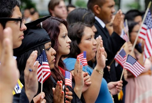 "DREAMers (Development, Relief, and Education for Alien Minors) and parents take an oath in a mock citizenship ceremony during a ""United we Dream,"" rally on Capitol Hill in Washington, Wednesday, July 10, 2013. (AP)"