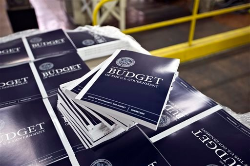 In this April 8, 2013, photo, copies of President Barack Obama's budget plan for fiscal year 2014 are prepared for delivery at the U.S. Government Printing Office in Washington.