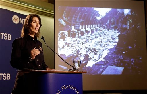 Deborah Hersman of the National Transportation Safety Board speaks in front of a photograph of some seats of Asiana Flight 214, which crashed on Saturday, July 6, 2013, at San Francisco International Airport.