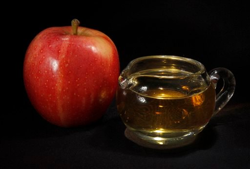In this Sept. 15, 2011 photo, an apple and a pitcher of apple juice are posed together in Moreland Hills, Ohio.
