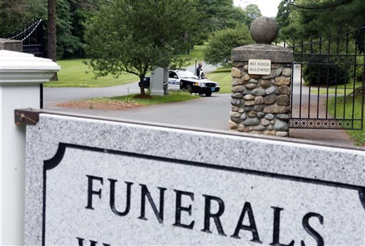 Peabody, Mass., police stand guard at Puritan Lawn Memorial Park Cemetery where authorities plan to exhume Albert DeSalvo's body from a grave to confirm a forensic link to a Boston Strangler case, Friday, July 12, 2013. (AP)