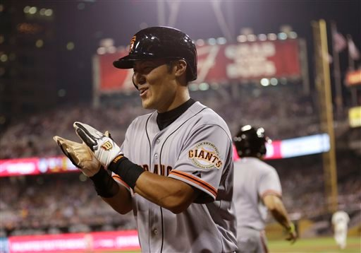 San Francisco Giants' Kensuke Tanaka of Japan claps after scoring against the San Diego Padres off a single by Andres Torres during the seventh inning in a baseball game Friday, July 12, 2013, in San Diego. (AP Photo/Gregory Bull)