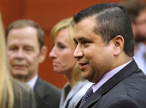 George Zimmerman leaves court with his family after Zimmerman's not guilty verdict was read in Seminole Circuit Court in Sanford, Fla. on Saturday, July 13, 2013.