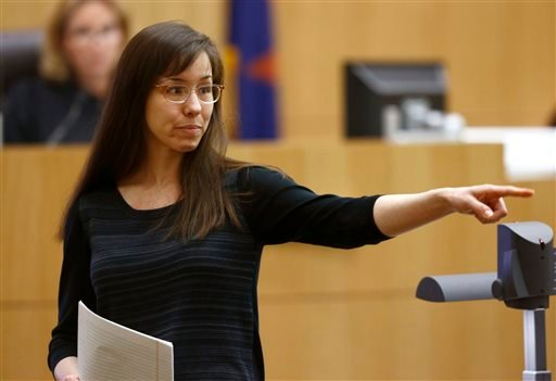 In this May 21, 2013 file photo, Jodi Arias points to her family as a reason for the jury to give her a life in prison sentence instead of the death penalty, during the penalty phase of her murder trial at Maricopa County Superior Court in Phoenix.