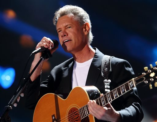 In this June 7, 2013 file photo, Randy Travis performs at the 2013 CMA Music Festival in Nashville Tenn.