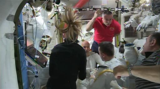 In this image from video made available by NASA, astronauts discuss the aborted spacewalk aboard the International Space Station on Tuesday, July 16, 2013.