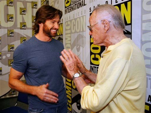 In this July 24, 2008 file photo, actor Hugh Jackman, left, talks to legendary comic book creator Stan Lee, right, after an interview at the Comic-Con 2008 convention in San Diego.