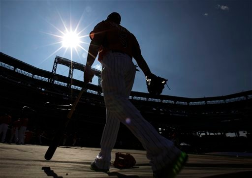 National League's Carlos Gonzalez, of the Colorado Rockies, walks to the batting cage before the MLB All-Star baseball game, on Tuesday, July 16, 2013, in New York.