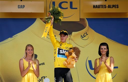 Christopher Froome of Britain, wearing the overall leader's yellow jersey, celebrates on the podium of the sixteenth stage of the Tour de France cycling race over 168 kilometers (105 miles) with start in in Vaison-la-Romaine and finish in Gap, France. (AP