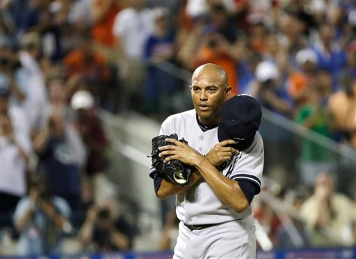 American League's Mariano Rivera, of the New York Yankees, acknowledges a standing ovation during the eighth inning of the MLB All-Star baseball game, on Tuesday, July 16, 2013, in New York.