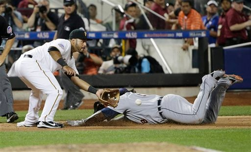 American League's Prince Fielder, of the Detroit Tigers, dives into third base for a triple ahead of the throw to National League's Pedro Alvarez, of the Pittsburgh Pirates.
