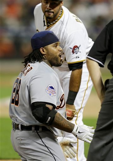 American League's Prince Fielder, of the Detroit Tigers, reacts after sliding into third base on a triple in the ninth inning of the MLB All-Star baseball game.