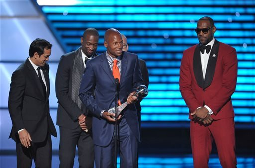 From left, Miami heat coach Erik Spoelstra and players Dwyane Wade, Ray Allen and LeBron James accept the award for best game at the ESPY Awards. (Photo by John Shearer/Invision/AP)