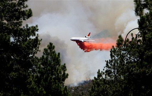 An air tanker makes a drop on the Mountain Fire near Lake Hemet, Calif. on Tuesday July 16, 2013. (AP Photo/The Press-Enterprise, Frank Bellino)
