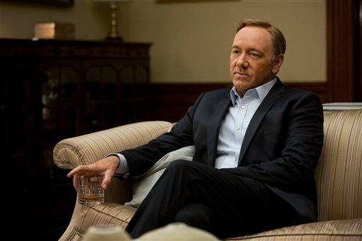 """This image released by Netflix shows Kevin Spacey in a scene from the Netflix original series, """"House of Cards,"""" an adaptation of a British classic."""