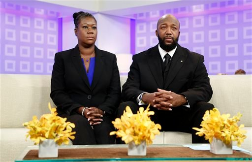 """In this image released by NBC, parents of Trayvon Martin, Sybrina Fulton, left, and Tracy Martin appear on the """"Today"""" show in New York. (AP Photo/NBC, Peter Kramer)"""