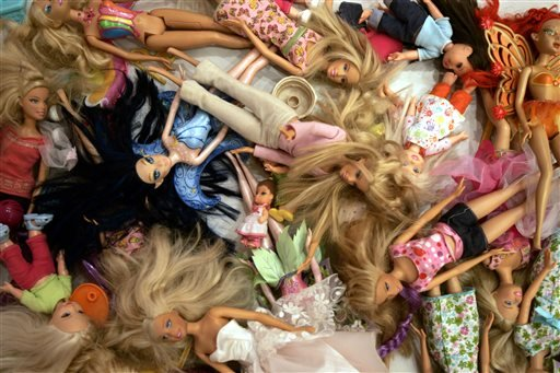 FILE - In this Oct. 31, 2007, file photo, Barbie dolls are seen at the Barbie Store in Buenos Aires. (AP)