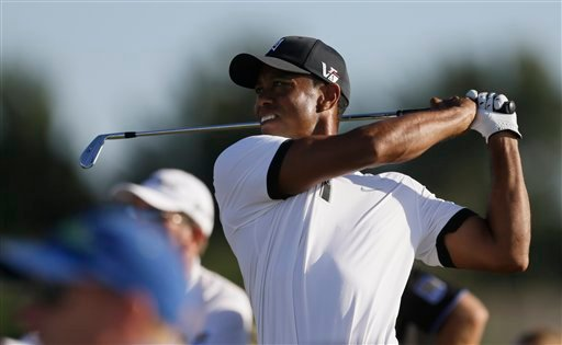 Tiger Woods of the United States plays a shot off the 16th tee during the first round of the British Open Golf Championship at Muirfield, Scotland, Thursday July 18, 2013. (AP Photo/Jon Super)