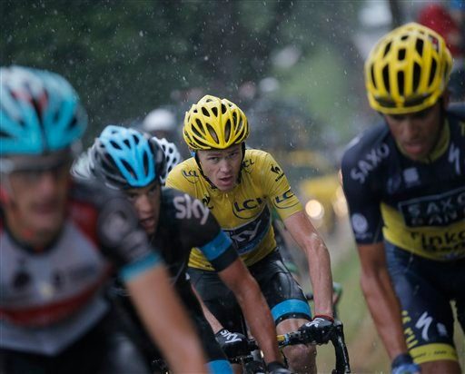 Spain's Alberto Contador, right, and Christopher Froome of Britain, wearing the overall leader's yellow jersey, climb La Croix Fry pass during the nineteenth stage of the Tour de France cycling race. (AP)