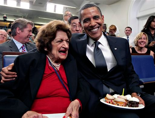 Aug. 4, 2009, file photo, veteran White House reporter Helen Thomas, left, celebrates her 89th birthday with President Barack Obama, celebrating his 48th birthday, in the White House Press Briefing Room. (AP Photo/J. Scott Applewhite, File)