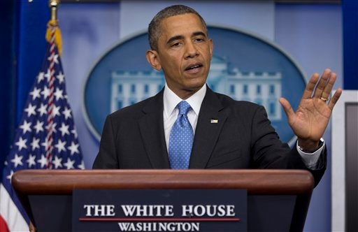 President Barack Obama gestures as he speaks during the daily news briefing at the White House, Friday, July 19, 2013, in Washington, about the fatal shooting of Trayvon Martin by George Zimmerman. (AP Photo/Carolyn Kaster)