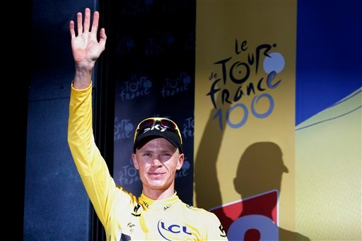 Christopher Froome of Britain, wearing the overall leader's yellow jersey, celebrates on the podium of the 20th stage of the Tour de France. (AP Photo/Christophe Ena)