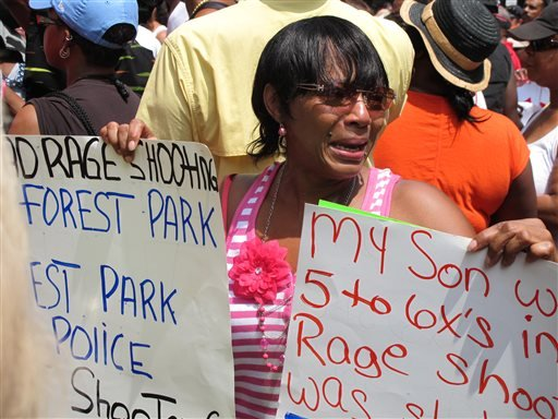 In this Saturday, July 20, 2013, photo, Patricia Dorsey of Cincinnati cries during a rally in downtown Cincinnati protesting the acquittal of George Zimmerman in the shooting death of Trayvon Martin.
