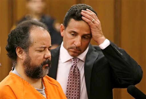 In this Wednesday, July 17, 2013 file photo, Ariel Castro, left, stands before a judge with defense attorney Craig Weintraub during Castro's arraignment on an expanded 977-count indictment, in Cleveland.