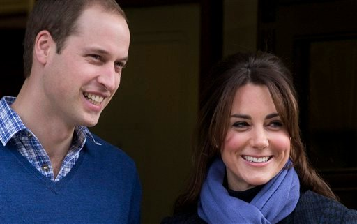 This is a Thursday, Dec. 6, 2012 file photo of Britain's Prince William stand next to his wife Kate, Duchess of Cambridge as she leaves the King Edward VII hospital in central London.