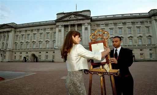 The Queen's Press Secretary Ailsa Anderson with Badar Azim, a footman, places an official document to announce the birth of a baby boy, at 4.24pm to the William and Kate, the Duke and Duchess of Cambridge at St Mary's Hospital.