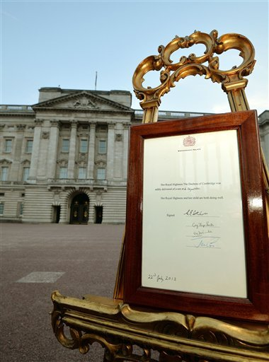 An easel stands in the forecourt of Buckingham Palace in London carrying an official document to announce the birth of a baby boy.
