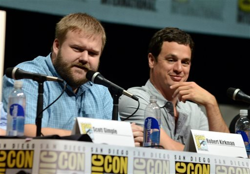"""Robert Kirkman, left, and David Alpert participate in """"The Walking Dead"""" panel on Day 3 of Comic-Con International on Friday, July 19, 2103, in San Diego. (Photo by Jordan Strauss/Invision/AP)"""