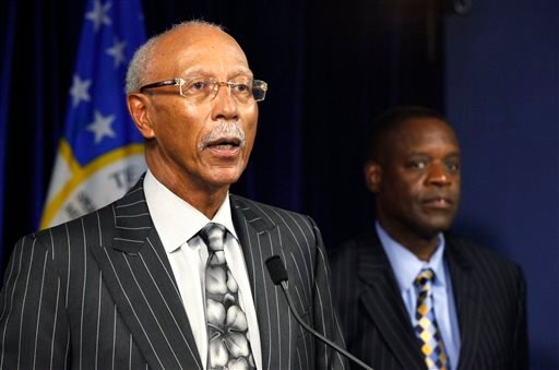 In this Thursday, July 18, 2013 file photo, Detroit Mayor Dave Bing, left, speaks as state-appointed emergency manager Kevyn Orr listens during a news conference in Detroit.