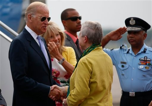 U.S. Vice President Joe Biden, left, accompanied by his wife Jill, second from left, shakes hands with U.S. Ambassador in India Nancy J. Powell upon his arrival at the airport in New Delhi, India, Monday, July 22, 2013.