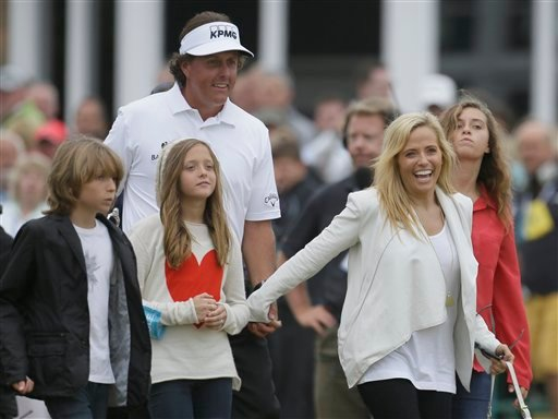 Phil Mickelson of the United States celebrates winning the British Open Golf Championship with his family at Muirfield, Scotland, Sunday July 21, 2013.(AP Photo/Jon Super)