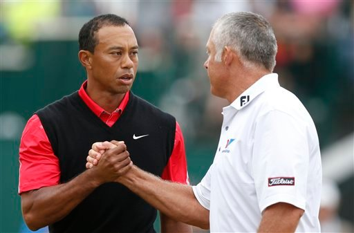 Tiger Woods of the United States shakes hands with Steve Williams, caddie of Adam Scott of Australia, after the final round of the British Open Golf Championship at Muirfield, Scotland, Sunday July 21, 2013. (AP Photo/Matt Dunham)