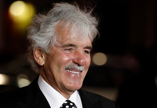 "In this Jan. 25, 2012 file photo, Dennis Farina arrives at the premiere for the HBO television series ""Luck"" in Los Angeles. (AP Photo/Matt Sayles, File)"