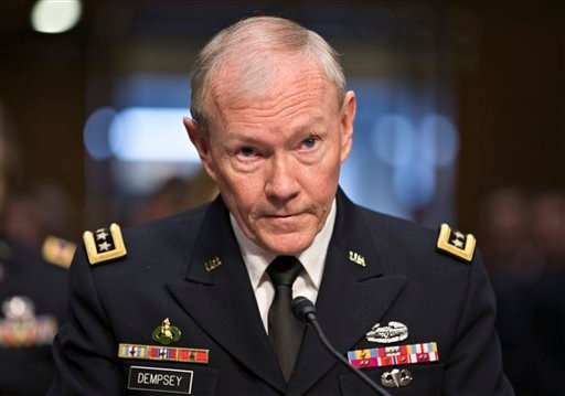 In this July 18, 2013 file photo, Gen. Martin Dempsey, chairman of the Joint Chiefs of Staff, appears before the Senate Armed Services Committee for a hearing to consider his reappointment to the military's highest post, on Capitol Hill in Washington.