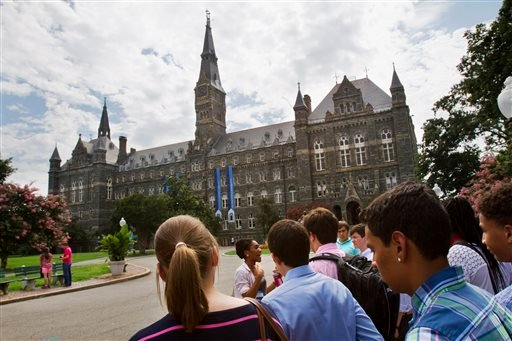 Prospective students tour Georgetown University's campus in Washington, in this Wednesday, July 10, 2013, file photo.