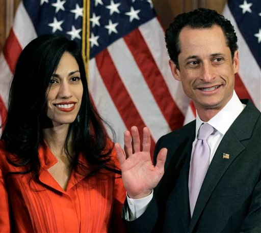 Jan. 5, 2011, file photo, Anthony Weiner and his wife Huma Abedin pose for photographs after the ceremonial swearing in of the 112th Congress on Capitol Hill in Washington. (AP Photo/Charles Dharapak, File)