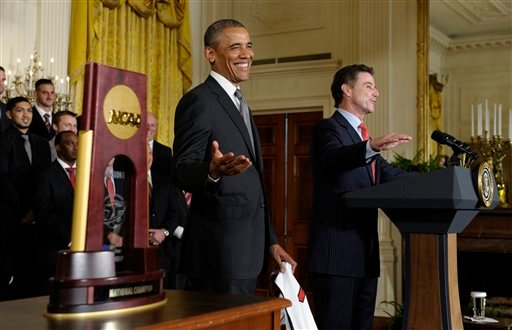 President Barack Obama laughs as Louisville men's basketball coach Rick Pitino, right, says he was disappointed that he didn't meet first lady Michelle Obama. (AP Photo/Susan Walsh)