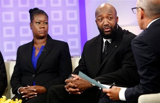 "In this image released by NBC, parents of Trayvon Martin, Sybrina Fulton, left, and Tracy Martin appear on the ""Today"" show with co-host Matt Lauer in New York. (AP)"