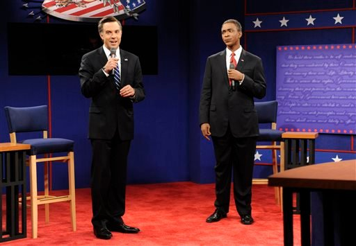 "This Oct. 20, 2012 photo released by NBC shows Jason Sudeikis portraying Republican presidential candidate Mitt Romney, left, and Jay Pharoah as President Barack Obama in a skit from ""Saturday Night Live,"" in New York. (AP)"