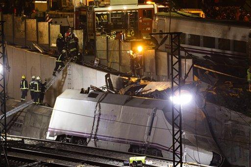 Emergency personnel respond to the scene of a train derailment in Santiago de Compostela, Spain, on Thursday, July 25, 2013. (AP Photo/Lalo Villar)