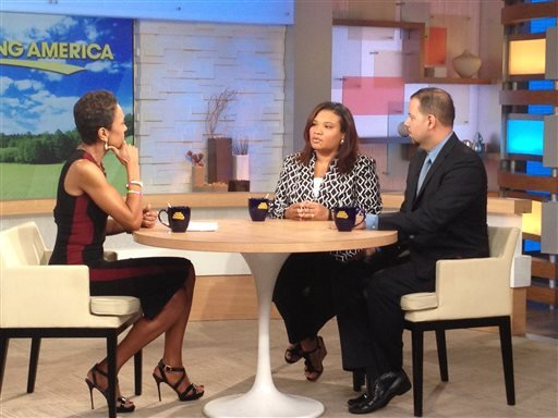 """This image released by ABC shows host Robin Roberts, left, with Juror B29 from the George Zimmerman trial, center, and attorney David Chico on """"Good Morning America,"""" in New York on Thursday, July 25, 2013. (AP)"""