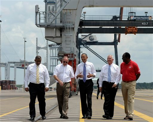 President Barack Obama, center, gets a tour of the Jacksonville, Fla. port. (AP)